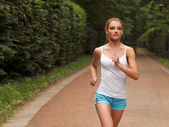 Running woman. Female runner jogging during outdoor — Stock Photo