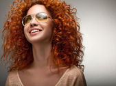 Red Hair. Beautiful Woman with Curly Long Hair and Sunglases — Stock Photo