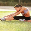 Beautiful Woman doing Stretching Exercise against Nature Backgro — Stock Photo