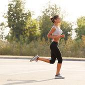 Woman Runner. Fitness Girl Running outdoors — Stock Photo