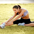 Portrait of Young Sporty Woman Doing Stretching Exercise. Athletic Workout. — Stock Photo