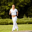Athletic Runner Training in a park for Marathon. Fitness Girl — Stock Photo