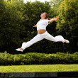 Happy Woman Outdoor. Jumping Girl Feels Free. Freedom concept. — Стоковая фотография