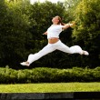 Happy Woman Outdoor. Jumping Girl Feels Free. Freedom concept. — Stockfoto