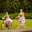 Stock Photo: Mother Daughter Riding Bicycles