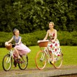 ストック写真: Mother Daughter Riding Bicycles