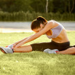 Portrait of Young Sporty Woman Doing Stretching Exercise. — Stock Photo