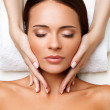 Face Massage. Close-up of a Young Woman Getting Spa Treatment. — Stock Photo #36422193