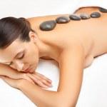 Stone Massage. Beautiful Woman Getting Spa Hot Stones Massage in — Stock Photo #39060653