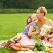 Happy family. A young mother and girl playing — Stock Photo #39551413