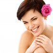 Spa Woman. Smiling Young Girl With a Flower against White — Stock Photo #40230103