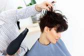 Hairdresser Using Dryer on Woman Wet Hair — Stock Photo