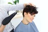 Hairdresser using dryer — Foto Stock