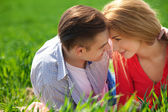 Young couple in love outdoor. They are smiling and looking at ea — Stock Photo