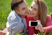 Couples taking selfie self portrait at the park — Stockfoto