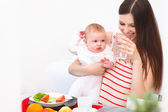 Mother and Baby eating at Home — Stock Photo