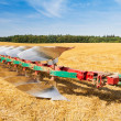 Plough ready to work on stubble field — Stock Photo #34268849