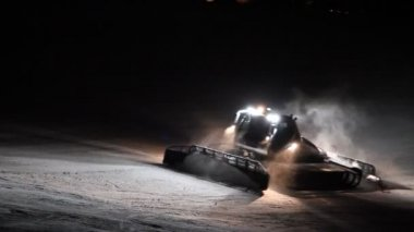 Snowplow smoothing a ski slope — Stock Video
