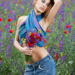 Fashion girl posing in spring flowers — Stock Photo