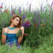 Pretty girl in spring meadow — Stock Photo #24492805