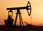 Oil pump at sunset — Stock Photo