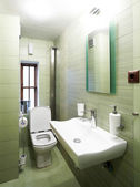 Modern green bathroom — Stock Photo