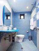 Modern blue bathroom — Stock Photo