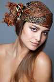 Beauty with a head scarf — Stock Photo