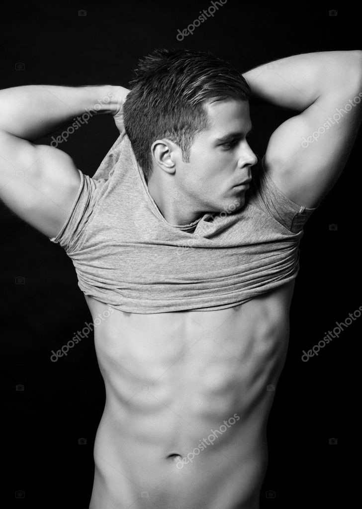 Portrait of a handsome muscular man on black background — Stock Photo #13299580