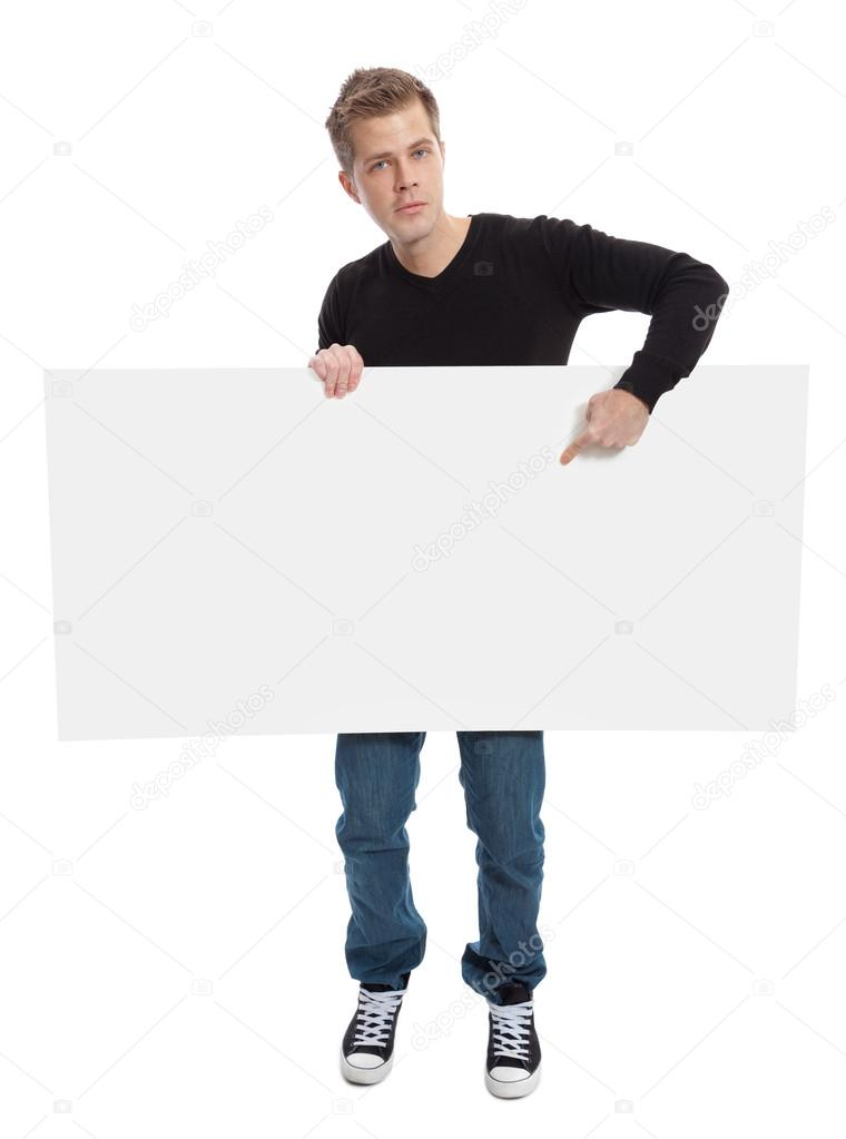 Casual young man holding a blank board — Stock Photo #16215725