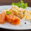 Salmon and scrambled eggs — Stock Photo
