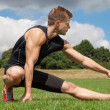 Stretching out in a park — Stock Photo