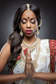Young Indian woman in traditional clothing with bridal makeup and jewelry — Stock Photo