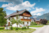 Traditional Alpine house in the mountains — Stock Photo