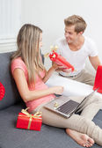 Happy couple exchanging gifts  — Stock Photo