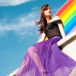 Girl on rainbow — Stock Photo