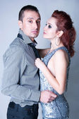 Sensual couple on gray — Stock Photo