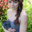 Girl with chinchilla - Stock Photo