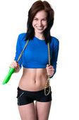 Happy brawny girl with skipping rope — Stock Photo