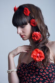 Roses in hair — Stock Photo