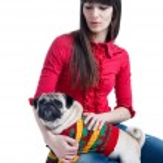 Girl with a pug dog — Stock Photo #36567597
