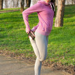 Woman doing leg stretching after running in the park — Stock Photo #47027251