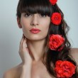 Woman in roses in her hair — Stock Photo #49737767