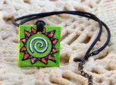 Clay amulet sun — Stock Photo