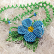 Blue bead pendant flower — Stock Photo #22178571