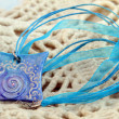 Blue clay amulet — Stock Photo #24114095