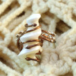 Handmade original ring of mother-of-pearl and wire — Stock Photo