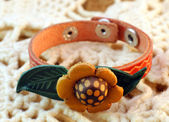 Handmade leather ethnic bracelet with a flower — Stock Photo