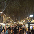 Tourists visits La Rambla street at night — Stock Photo
