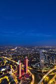 Skyscrapers, Bosphorus and bridge at night, Istanbul, Turkey — Stock Photo